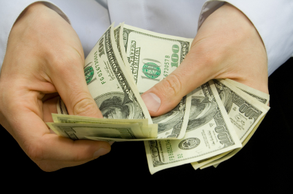 Learn the advantages and disadvantages of paying with cash versus credit cards.