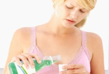 Woman Using Mouthwash (1)