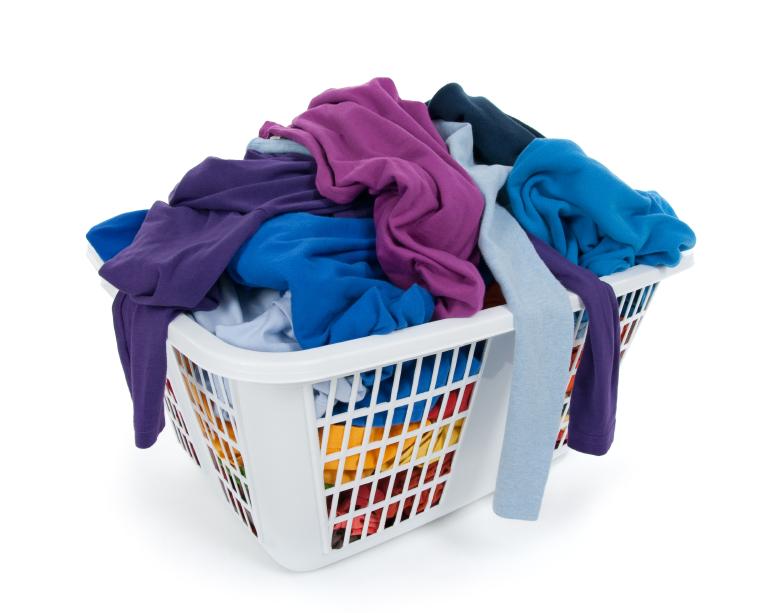 Bright clothes in laundry basket. Blue, indigo, purple.