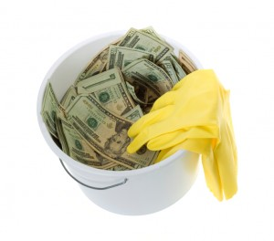 Twenty Dollar Bills in White Cleaning Bucket with latex gloves
